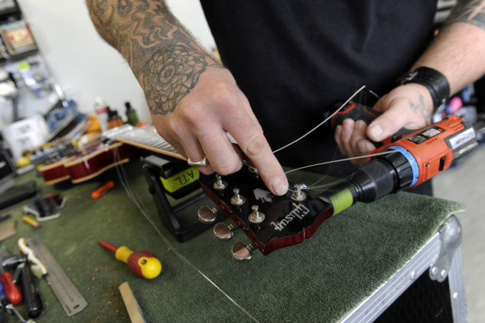 PHOTO ESSAY: Old Chapel Studios, Holbeck. Guitar Technician Ben Shand, BeeJ Guitar repairs. The first purpose built rehearsal studio in Leeds, opening in 1982 as Parkside Studios in Armley, later moving to an old Wesleyan chapel building at Czar Street, Holbeck, becoming Old Chapel Music Studios in 1992. From the start the studios have been the starting blocks for several of the most successful acts to emerge from Leeds since the early 80's - The Wedding Present, Sisters of Mercy, Red Lorry Yellow Lorry, The Mission, Age of Chance, The March Violets, Cud, Embrace, Duels, Kaiser Chiefs, I Like Trains, The Pigeon Detectives, Pulled Apart By Horses - the list goes on, not to mention the countless equally talented, but less famous bands, working pub and club acts, wedding bands, school bands etc. A Community Interest Company trading for Leeds Music Trust. They work with professional and amateurs of all levels, and with partners to provide the best service for all and support for those who would not otherwise have the opportunity to take part. 1 September 2015. Picture Bruce Rollinson